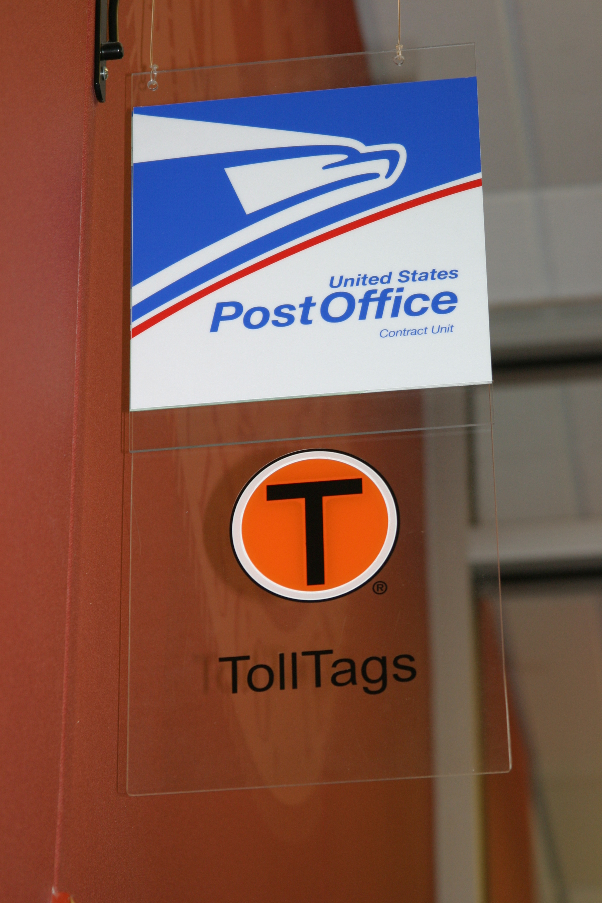 Postal Unit and TollTag sign